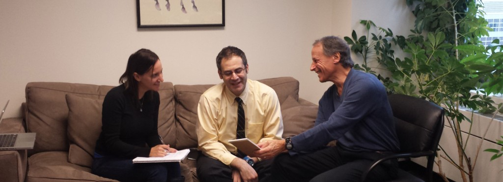 Dr. John Rolland (r) meeting with 2015-16 fellows Limor Gildenblatt (l) and Hernan Barenboim (c)